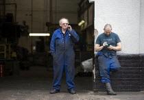 Workers at an engineering factory take a fag break outside. Digbeth, Birmingham. - John Harris - 24-05-2012