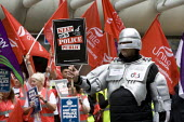 Unite police staff joined by Robocop - the cyborg law enforcer of the 1980s sci-fi classic. Police staff protest against Police privatisation outside meeting of the West Midlands Police Authority, Bir... - John Harris - Protest,2010s,2012,activist,activists,adult,adults,against,Birmingham,CAMPAIGNING,CAMPAIGNS,DEMONSTRATION,meeting,MEETINGS,member,member members,members,outside,police,POLICING,privatisation,privatise