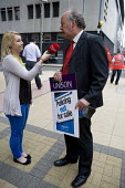 Charlie Sarell, Unison organiser, being interviewed by a broadcast journalist from Heart FM radio station. Police staff protest against Police privatisation outside meeting of the West Midlands Police... - John Harris - 24-05-2012