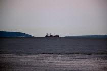 Container cargo ship sailing the Bristol Channel into the Atlantic - John Harris - 2010s,2012,boat,boats,capitalism,capitalist,cargo,coast,coastal,coasts,container,containers,EBF,Economic,Economy,export,exporting,exports,Industries,industry,maker,makers,making,marine,maritime,mariti