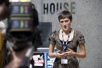 BBC journalist recording a report to camera, anti privatisation protest, Birmingham - John Harris - 12-07-2012