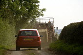 Car following a Tractor and Hay baler down a narrow single track lane, Warwickshire - John Harris - 03-09-2012