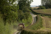 Tractor and Hay baler being driven down a narrow single track lane, Warwickshire - John Harris - 03-09-2012