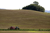 Tractor and Hay baler being driven down a narrow farm track, Warwickshire - John Harris - 03-09-2012