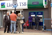 Shoppers in Bilston outside Lloyds TSB branch, Wolverhampton - John Harris - ,2010s,2012,adult,adults,AGE,ageing population,ATM,bank,banking,banks,bought,boy,boys,buy,buyer,buyers,buying,cash,Cash Machine,cash point,cashmachine,cashpoint,child,CHILDHOOD,children,cities,city,Ci