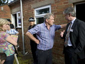 Glyn Davies MP argues with Jeremy Lee, lead project manager for National Grid as Protesters from Montgomeryshire Against Pylons occupy the SPEN and National Grid Public consultation event and exhibiti... - John Harris - 08-08-2012