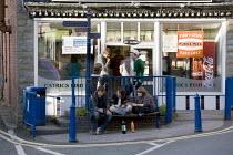 Teenagers talking outside Catrics Fishbar, Fish and chip shop, village of Llanfair Caereinion, Welshpool, Wales - John Harris - 08-08-2012