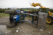 A Road Traffic accident involving a tractor and trailer emerging from a farm gateway and a passing HGV lorry. The tractor was knocked over but the driver was unhurt. Vale of Evesham - John Harris - 24-09-2012