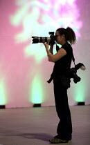 Photojournalist Jess Hurd taking pictures at 2012 TUC Congress Brighton - John Harris - 12-09-2012