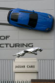 Jaguar XKR-S sports car on the side of the Castle Bromwich Assembly factory and the brand  Leaping jaguar mascot. It is owned by Jaguar Land Rover (TATA). Birmingham - John Harris - 20-10-2012