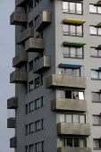 A tenant cleaning the widows of his flat. Topcliffe House has been refurbished by the Castle Vale Housing Action Trust and BM3 Architecture in the final phase of the project. Metal balconies and brigh... - John Harris - 2010s,2012,accommodation,ACE,apartment,apartments,architecture,arts,Birmingham,blocks,building,buildings,Castle,cities,city,cleaning,cleansing,communities,community,council estate,council services,cou