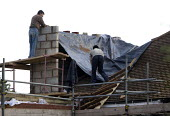 Builders at work on a roof extension to a house. Buckland End, Birmingham - John Harris - 20-10-2012