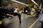 BMW Group Mini production line, Cowley, Oxford - John Harris - ,2010s,2012,assembly,AUTO,auto industry,AUTOMOBILE,AUTOMOBILES,Automotive,BAME,BAMEs,Black,BME,bmes,BMW,capitalism,capitalist,car,Car Industry,carindustry,cars,diversity,EBF,Economic,Economy,employee,