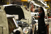 BMW Group Mini production line, Cowley, Oxford - John Harris - 2010s,2012,assembly,AUTO,auto industry,AUTOMOBILE,AUTOMOBILES,Automotive,BAME,BAMEs,Black,BME,bmes,BMW,capitalism,capitalist,car,Car Industry,carindustry,cars,diversity,EBF,Economic,Economy,employee,e