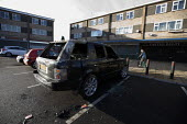 A burnt out Land Rover Vogue SUV car, Hodge Hill, a poor area of Birmingham - John Harris - 2010s,2012,4x4,against,anti,anti social behavior,anti social behaviour,anti socialanti social behavior,antisocial,antisocial behaviour,antisocialvandalise,antisocialvandalize,arson,AUTO,AUTOMOBILE,AUT