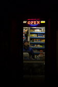 Corner shop, Foeshill, Coventry - John Harris - 2010s,2012,asian asians,BME black,business,cigarette,cigarettes,cold,counter,display,displays,dusk,EARNINGS,EBF Economy,EQUALITY,ethnic,ETHNICITY,evening,grocery,high,Income,INCOMES,inequality,light,l