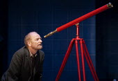 Ian McDiarmid as Galileo looking through his telescope in A Life of Galileo. RSC, Swan, Stratford-upon-Avon - John Harris - 07-02-2013