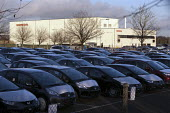 New cars parked outside the Honda South Marston plant, Swindon, where 800 jobs are to go. The redundancies are the result of falling demand due to the ongoing recession. - John Harris - 10-01-2013