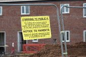 A notice warning the public and parents of the dangers of trespassing on the building site. Construction of new social housing, Stratford-upon-Avon, Warwickshire - John Harris - 28-02-2013