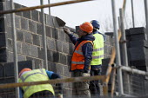 Construction of new social housing, Stratford-upon-Avon, Warwickshire - John Harris - 2010s,2013,Breeze Block,Breeze Blocks,brick,bricklayer,bricklayers,bricklaying,bricks,Brownfield Site,builder,builders,building,building site,Building Worker,BUILDINGS,by hand,capitalism,capitalist,Co