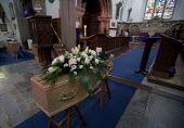Funeral, St Peter's Church, Wellesbourne, Warwickshire. - John Harris - ,&,2010s,2013,belief,bouquet of flowers,bunch of,casket,ceremonial,ceremonies,ceremony,christian,christianity,christians,church,Church of England,churches,cofe,coffin,coffins,conviction,death,deaths,d