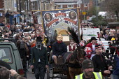 A march with NUM banners, led by a mock hearse with an effigy of Margaret Thatcher and a former miner. Protest on the day of the funeral of Margaret Thatcher, Goldthorpe - a former pit village, South... - John Harris - 17-04-2013