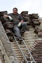 A roofer taking a break. Restoration of the church roof, Loxley village Parish church St Nicholas, Warwickshire. - John Harris - 03-05-2013