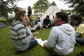 Students in discussion use hand signals used by Occupy protesters to negotiate a consensus in the camp outside the occupied building. Protect The Public University, student Occupation of Warwick Unive... - John Harris - 22-06-2013