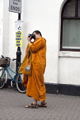 Tibetan monk taking photographs, Stratford upon Avon. - John Harris - &,2010s,2013,Amateur Photographer,belief,buddha,Buddhism,buddhist,buddhists,burial,camera,cameras,conviction,dress,faith,GOD,hobbies,hobby,hobbyist,holiday,holiday maker,holiday makers,holidaymaker,ho