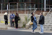 Students smoking and talking outside Dudley College of Further Education, Dudley - John Harris - 17-06-2013