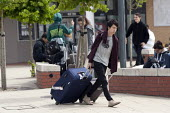 Students leaving Warwick University with their luggage as the break up at the end of the Summer term - John Harris - ,2010s,2013,asian,asians,bag,bags,BAME,BAMEs,BME,bmes,break,chinese,diversity,edu,educate,educating,education,educational,End Of Term,ethnic,ethnicity,Foreign Student,Higher Education,journey,journeys