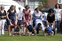 A wheelbarrow race, Alveston Summer Fete on the village green, Warwickshire - John Harris - 29-06-2013