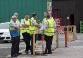 Mangement watch BFAWU members on strike at Hovis (Premier Foods) Wigan over the introduction of agency staff on Zero Hours contracts, redundancies and a reduction in hours from 52 to 40 per week. - John Harris - 2010s,2013,agency,BFAWU,DISPUTE,DISPUTES,EARNINGS,EQUALITY,Income,INCOMES,INDUSTRIAL DISPUTE,industrial relations,inequality,living wage,low pay,Low Income,low paid,low pay,management managing manager