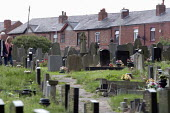 Graveyard, Lancashire - John Harris - 2010s,2013,adult,adults,belief,cemeteries,CEMETERY,christian,christianity,christians,CHURCH,churches,churchyard,churchyards,conviction,couple,COUPLES,death,deaths,died,EBF,Economic,Economy,faith,FEMAL