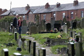 Graveyard, Lancashire - John Harris - 2010s,2013,adult,adults,belief,cemeteries,CEMETERY,christian,christianity,christians,CHURCH,churches,churchyard,churchyards,conviction,council services,council services,couple,COUPLES,death,deaths,die
