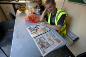 Construction workers reading The Sun and page 3 in the break. Building site, Warwickshire - John Harris - 21-08-2013
