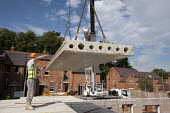 Lower ring concrete slabs into place on the roof. Building luxury apartments, Warwickshire - John Harris - 21-08-2013