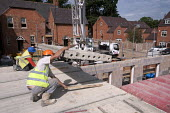 Lower ring concrete slabs into place on the roof. Building site, Warwickshire - John Harris - 21-08-2013