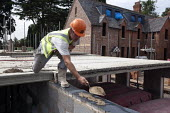 Adding cement for concrete roof slabs, bulding site, Warwickshire - John Harris - 21-08-2013