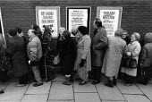 Pensioners and the unemployed queueing to receive milk and butter from the Salvation Army distributing part of the E.E.C. intervention store surplus of 1.4 million tons of unsold subsidised butter cre... - John Harris - &,1980s,1987,adult,adults,age,ageing population,aid,assistance,belief,bible,biblical quote,biblical quotes,Birmingham,butter,CAP,charitable,charity,christian,christianity,cities,city,communities,Commu