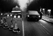 Police roadblock to prevent picketing at pits in the Midlands - John Harris - 1980s,1984,adult,adults,AUTO,AUTOMOBILE,AUTOMOBILES,AUTOMOTIVE,car,cars,check,checking,checkpoint,CLJ,DISPUTE,DISPUTES,driver,drivers,driving,halt,halted,halting,INDUSTRIAL DISPUTE,MATURE,member,membe
