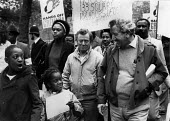 Jim Slater (NUS) and children. Hands off grenade protest after the invasion by USA, London - John Harris - 1980s,1983,activist,activists,against,BAME,BAMEs,black,BME,bmes,boy,boys,CAMPAIGN,campaigner,campaigners,CAMPAIGNING,CAMPAIGNS,child,CHILDHOOD,children,cultural,DEMONSTRATING,demonstration,DEMONSTRATI
