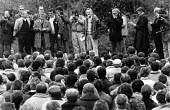 NUS P & O dispute. A mass meeting of seamen sacked by P&O being addressed by Jim Slater (NUS), the meeting voted to continue the 13 week strike, Dover - John Harris - 1980s,1988,disputes,europeregi,INDUSTRIAL DISPUTE,mass,mass meeting mass meetings,meeting,MEETINGS,member,member members,members,nus,people,seafarer seafarers,seaman seamen,SPEAKER,SPEAKERS,speaking,S