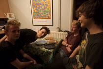 Teenagers having fun at home. - John Harris - &,2010s,2013,adolescence,adolescent,adolescents,Emilio,having fun,leisure,lfL,LIFE,lifestyle,PEOPLE,person,persons,RECREATION,RECREATIONAL,saturday,teen,teenage,teenager,teenagers,teens,visit,visiting