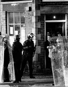 Riot police occupy the village to get scabs out. Houghton Main, Yorkshire - John Harris - 01-02-1985