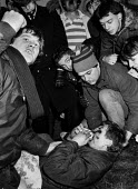 Pickets help a picket hit in the face by a police truncheon, 1984. Conflict with police. Miner's strike, Thoresby Colliery, Nottinghamshire - John Harris - 1980s,1984,adult,adults,anger,angry,assault,assaults,baton,batons,CLJ,Coal Mine,collieries,colliery,Conflict,confront,confrontation,confronted,confronting,DISPUTE,disputes,EMOTION,EMOTIONS,force,Indus