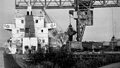 Imported Polish coal being unloaded onto lorries for transport to BSC Scunthorpe Steelworks inorder to break the strike. Flixborough Wharf, Scunthorpe, South Humberside - John Harris - 15-08-1984
