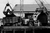 Imported Polish coal being unloaded onto lorries for transport to BSC Scunthorpe Steelworks inorder to break the Miners strike. Flixborough Wharf, Scunthorpe, South Humberside - John Harris - 15-08-1984