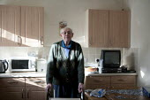 A pensioner at home, a Housing Association house. Stratford upon Avon, Warwickshire. - John Harris - ,2010s,2014,adult,adults,age,ageing population,disabilities,disability,disable,disabled,disablement,elderly,EQUALITY,excluded,exclusion,fail,frailty,HARDSHIP,home,house,houses,housing,impoverished,imp