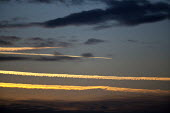 Aircraft contrails as the sunsets - John Harris - 2010s,2014,aeroplane,aeroplanes,Air Pollution,Air Quality,air transport,aircraft,aircraft exhaust,airplane,airplanes,airspace,aviation,climate change,cloud,clouds,condensation trail,condensed,condensi